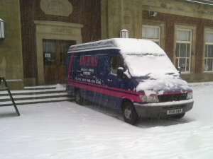 Photo - Waiting in the snow to move a grand piano from the cafe at Stanley Park, Blackpool